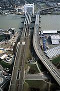 Nederland, Zuid-Holland, Dordrecht, 08-03-2002; in ZO richting, de Oude Maas met spoorbrug: het witte gedeelte van deze brug is de voor Dordrecht karakteristieke hefbrug; rechts de brug voor lokaal verkeer, voorgrond Zwijndrecht; bundeling infrastuctuur; knooppunt binnenvaart  stadsgezicht verkeeren vervoer;<br /> luchtfoto (toeslag), aerial photo (additional fee)<br /> foto /photo Siebe Swart
