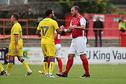 Ebbsfleet united attacker Danny Kedwell (9) shaking hands with AFC Wimbledon striker Andy Barcham (17) during the Pre-Season Friendly match between Ebbsfleet and AFC Wimbledon at Stonebridge Road, Ebsfleet, United Kingdom on 29 July 2017. Photo by Matthew Redman.