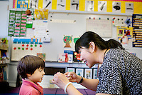 Chinese immersion program teacher, Jennie Lee, speaks Cantonese with Henry Garrett, 4, during a math exercise, at West Portal Elementary School, in San Francisco, Ca., on Friday, Sept. 11, 2009. The program celebrates its 25th anniversary.