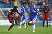 Coventry City midfielder Gael Bigirimana (5) left and Gillingham forward Rory Donnelly (9) during the EFL Sky Bet League 1 match between Gillingham and Coventry City at the MEMS Priestfield Stadium, Gillingham, England on 24 September 2016. Photo by Martin Cole.