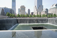 The entrance to the National 9/11 Memorial Museum, visible at left,  will include extensive exhibits underground.