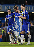 Eden Hazard, Oscar and Branislav Ivanovic of Chelsea ceebrate victory over Liverpool after the Capital One Cup Semi Final 2nd Leg match between Chelsea and Liverpool at Stamford Bridge, London, England on 27 January 2015. Photo by David Horn.