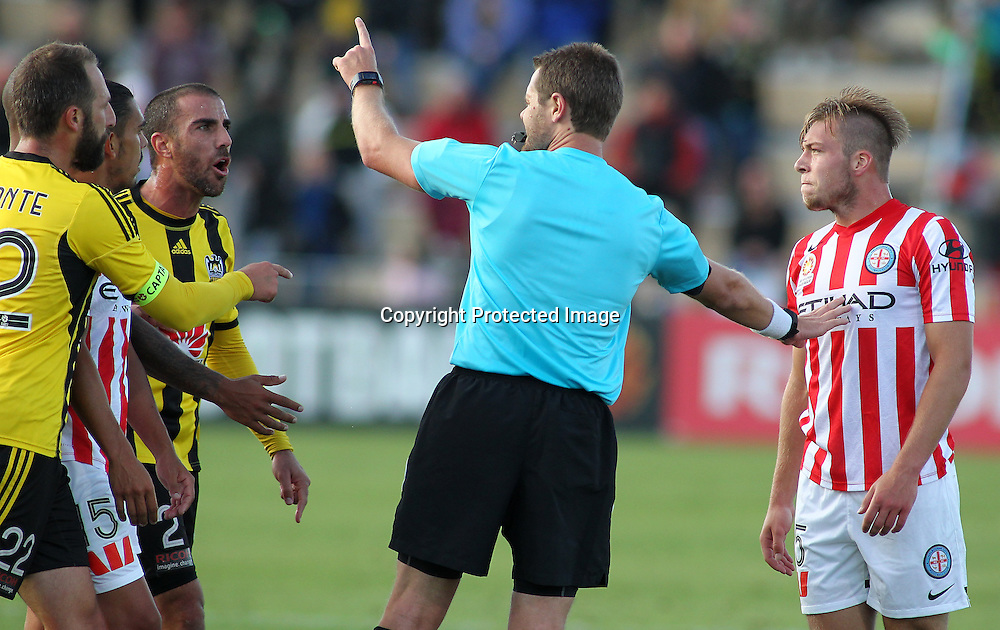 Phoenix' Andrew Durante & Emmanuel Muscat argue with the referee while he holds back Melbournes' Jacob Melling during the A-League football match between the Wellington Phoenix & Melbourne City, at the Hutt Recreational Ground, Wellington, 14 February 2015. Photo.: Grant Down / www.photosport.co.nz