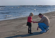 Dominick Terminie and his daughter, Kaelyn Terminie, 4, gather seashells March 6, 2011 in Grand Isle, La. The island was heavily impacted by the Deepwater Horizon oil spill April 20, 2010 and continues to recover. The beach has been closed since the oil spill but re-opened in February. (Photo by Carmen K. Sisson)