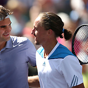 March 15, 2014 Indian Wells, California. Roger Federer defeats Alexandr Dolgopolov in the semifinals of the 2014 BNP Paribas Open. (Photo by Billie Weiss/BNP Paribas Open)