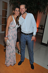 JAKE PARKINSON-SMITH and his wife SAMIRA at the Veuve Clicquot Experience at The Hurlingham Party following the Polo in The Park held at the Hurlingham Club, London SW6 on 8th June 2012.