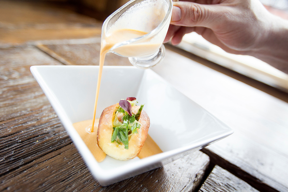 Lobster bisque poured on a toasted brioche lobster roll with shrimp, parsley, chive, tarragon, and chervil at Travail and the Rookery in Robbinsdale April 18, 2014.