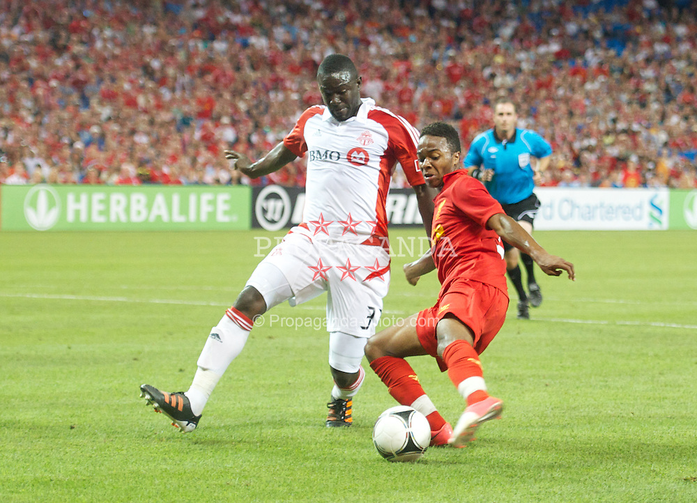 TORONTO, CANADA - Saturday, July 21, 2012: Liverpool's Raheem Sterlings beats the Toronto defender on his way to setting up the equalising goal during the first match of the North American pre-season tour at the Rogers Centre. (Pic by David Rawcliffe/Propaganda)