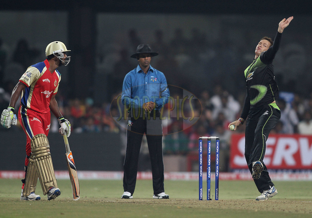 Juan Rusty Theron of the Warriors sends down a delivery during match 1 of the NOKIA Champions League T20 ( CLT20 )between the Royal Challengers Bangalore and the Warriors held at the  M.Chinnaswamy Stadium in Bangalore , Karnataka, India on the 23rd September 2011..Photo by Shaun Roy/BCCI/SPORTZPICS
