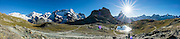 """Riffelsee. From Rotenboden, from left to right are the peaks of: Monte Rosa massif / Dufourspitze (4634 m / 15,203 ft, second-highest mountain of the Alps and highest of Switzerland), Castor & Pollux, Breithorn (""""broad horn"""", 4164 m) and Matterhorn in the Pennine/Valais Alps, Europe. In Zermatt, the Gornergrat rack railway (GGB) takes you to a spectacular ridge (at 3135 m or 10,285 ft) between Gornergletscher and Findelgletscher. Gornergrat train, opened in 1898, climbs almost 1500 m or 4900 ft. Gornergrat train, opened in 1898, climbs almost 1500 m or 4900 ft via Riffelalp and Riffelberg. This image was stitched from multiple overlapping photos."""
