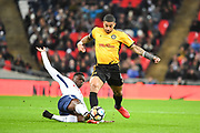 Tottenham Hotspur Midfielder Victor Wanyama (12) and Newport County Midfielder Joss Labadie (4) battle for the ball during the The FA Cup 4th round replay match between Tottenham Hotspur and Newport County at Wembley Stadium, London, England on 7 February 2018. Picture by Stephen Wright.