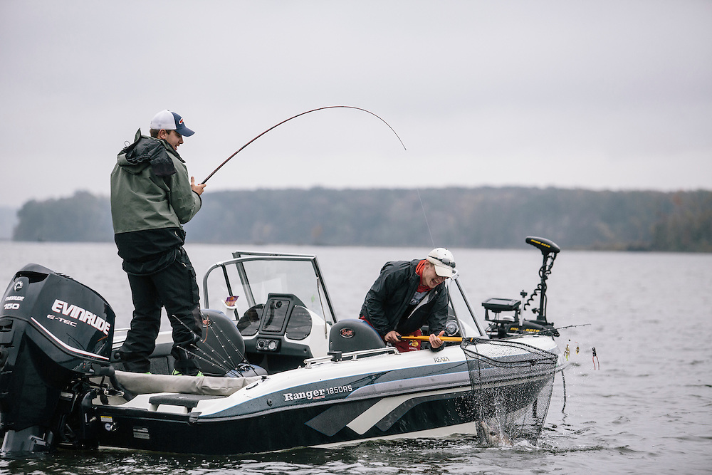 Ricky Lee, left, of State University of New York -Plattsburgh and teammate Brendan Bolis, right, haul in a fish during the FLW College Fishing Northern Conference Invitational in Marbury, MD on Oct. 11, 2014. Only the top 15 of 43 teams moved on to Sunday.