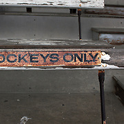A rusted sign on the seating in the spectator stands during a day at the Races at the Gore Race Meeting, Gore, Southland, New Zealand. 18th December 2011. Photo Tim Clayton