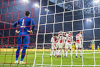 AMSTERDAM - Ajax - ADO , Voetbal , Eredivisie , Seizoen 2016/2017 , Amsterdam ArenA , 29-01-2017 , eindstand 3-0 ,  Ajax speler Kasper Dolberg viert zijn doelpunt voor de 3-0 terwijl ADO Den Haag speler Ernestas Setkus (l) baalt