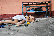 Manila, Philippines, young boy sleeping in the street
