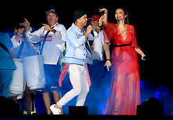Guy Sebastian performs on stage with Ricki-Lee Coulter during the Closing Ceremony for the 2018 Commonwealth Games at the Carrara Stadium in the Gold Coast, Australia.