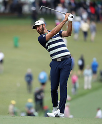 April 7, 2018 - Augusta, GA, USA - Dustin Johnson hits from the 1st fairway during the third round of the Masters Tournament on Saturday, April 7, 2018, at Augusta National Golf Club in Augusta, Ga. (Credit Image: © Jason Getz/TNS via ZUMA Wire)