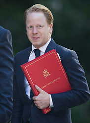 © Licensed to London News Pictures. 19/07/2016. London, UK. Ben Gummer MP, Minister for the Cabinet Office and Paymaster General, arrives in Downing Street for Prime Minister Theresa May's first cabinet.  Photo credit: Peter Macdiarmid/LNP