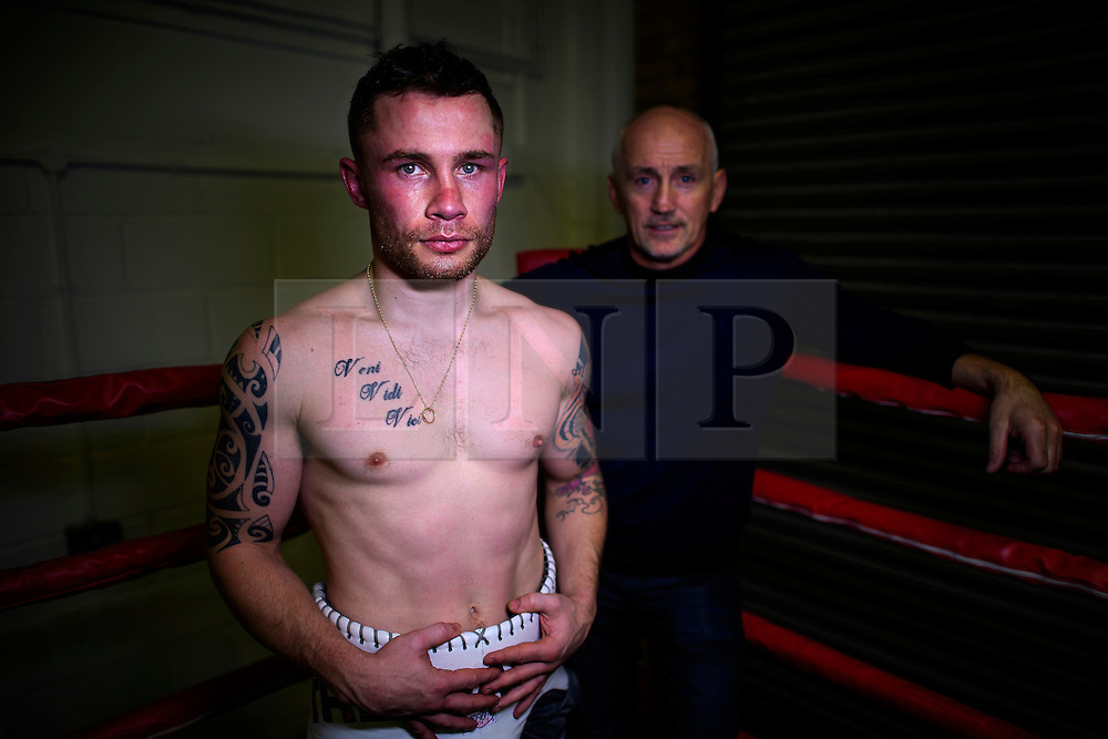 © London News Pictures. 29/12/2016. Two-weight world boxing champion, Carl Frampton, nickname The Jackal, pictured posing for a portrait at his gym in south London with manager Barry McGuigan. Frampton has been named ESPN's fighter of the year. Photo credit: Ben Cawthra/LNP