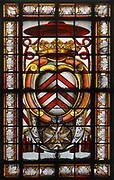 Coat of arms of Richelieu, with the cardinal's hat above, 19th century copy of the original stained glass window, in the Chapelle de la Sorbonne, or La Chapelle Sainte Ursule de la Sorbonne, built 1635-42 by architect Jacques Lemercier, at the Sorbonne, the main building of the University of Paris, in the 5th arrondissement of Paris, France. Cardinal Richelieu was the principal of the Sorbonne and is buried in the chapel. The chapel is listed as a historic monument. Picture by Manuel Cohen