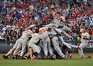 Oregon State Beavers players leap into a dog pile celebrating after defeating the Arkansas Razorbacks for the National Championship during the College World Series Championship Series at TD Ameritrade Park in Omaha, Nebraska.