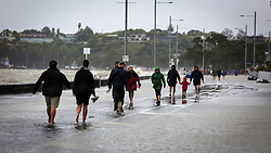 Pedestrians make the most of road closures on Tamaki Drive as king tides flood over the sea wall, Auckland, New Zealand, Friday, January 05, 2018. Credit:SNPA / Hayden Woodward**NO ARCHIVING**