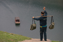 April 12, 2018 - Jinping, Guizhou, China - Zhang Linchang, a village postman walked 240 thousand kilometres and delivered 1.4 million newspapers and letters to the villagers who lives in remote mountains in 31 years in Jinping. (Credit Image: © TPG via ZUMA Press)