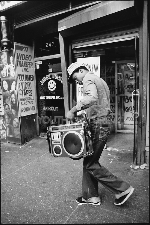 Man walking down the street with his ghetto blaster in his hands, New York, USA, 1980