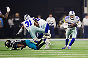 ARLINGTON, TX - OCTOBER 14:  Jeff Heath #38 of the Dallas Cowboys intercepts a pass thrown to Dede Westbrook #12 of the Jacksonville Jaguars in the third quarter at AT&T Stadium on October 14, 2018 in Arlington, Texas.  The Cowboys defeated the Jaguars 40-7.  (Photo by Wesley Hitt/Getty Images) *** Local Caption *** Jeff Heath; Dede Westbrook