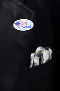 """A voter displays his """"I Voted"""" sticker after voting at the Van Zandt-Guinn Elementary School in Fort Worth, Texas on March 4, 2014. (Cooper Neill / for The Texas Tribune)"""