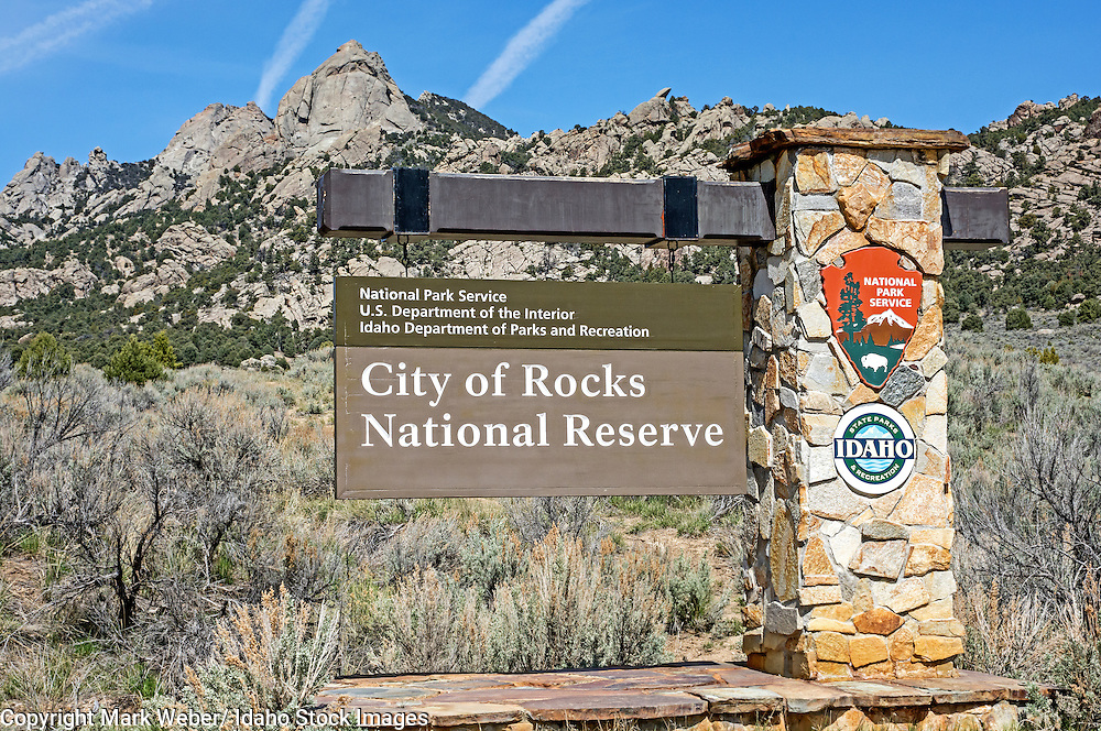 City Of Rocks, Stienfells Dome towers over the entrance sign at the City Of Rocks National Reserve near the town of Almo in southern Idaho