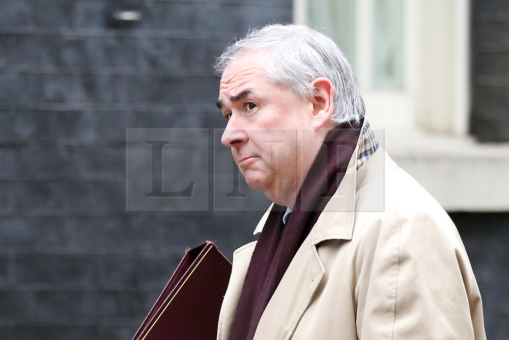"""© Licensed to London News Pictures. 18/12/2018. London, UK. Geoffrey Cox - Attorney General arrives in Downing Street for the weekly Cabinet meeting. The Cabinet will discuss the preparations for a """"No Deal"""" Brexit. Photo credit: Dinendra Haria/LNP"""