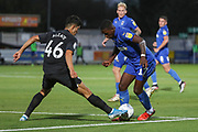 AFC Wimbledon attacker Michael Folivi (17) battles for possession with Brighton and Hove Albion midfielder Steven Alzate (46) during the EFL Trophy (Leasing.com) match between AFC Wimbledon and U23 Brighton and Hove Albion at the Cherry Red Records Stadium, Kingston, England on 3 September 2019.