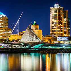 Picture of Milwaukee skyline at night. Picture includes the Milwaukee lakefront, Milwaukee Art Museum, University Club Tower, and Northwestern Mutual Tower. Photo is high resolution.