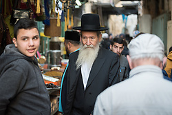 19 April 2019, Jerusalem: A Jewish man walks down Al-Wad street towards the Western Wall. On the first day of Pesach (Passover) Jews gather to pray by the Western Wall in Jerusalem, considered as the most sacred and holy place for the Jews.