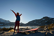 Backpacker does yoga at camp in the granite around Lake Aloha in the Desolation wilderness hike in south lake tahoe