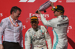November 3, 2019, Austin, TX, USA: AUSTIN, TX - NOVEMBER 03: Teammate Mercedes AMG Petronas Motorsport driver Valtteri Bottas (77) of Finland pours champagne on the head of Mercedes AMG Petronas Motorsport driver Lewis Hamilton (44) of Great Britain after clinching the 2019 FIA Formula 1 World Championship following the F1 - U.S. Grand Prix race at Circuit of The Americas on November 3, 2019 in Austin, Texas. (Photo by Ken Murray/Icon Sportswire) (Credit Image: © Ken Murray/Icon SMI via ZUMA Press)