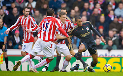 STOKE, ENGLAND - Saturday, January 16, 2010: Liverpool's David Ngog in action against Stoke City during the Premiership match at the Britannia Stadium. (Photo by David Rawcliffe/Propaganda)