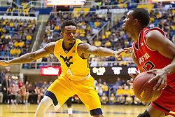 Feb 18, 2017; Morgantown, WV, USA; West Virginia Mountaineers guard Daxter Miles Jr. (4) guards Texas Tech Red Raiders guard Keenan Evans (12) before shooting a three pointer from the corner during the first half at WVU Coliseum. Mandatory Credit: Ben Queen-USA TODAY Sports