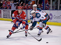 KELOWNA, CANADA, DECEMBER 27: Michael Aviani #16 of the Spokane Chiefs is checked by Kevin Smith #3 of the Kelowna Rockets at the Kelowna Rockets on December 7, 2011 at Prospera Place in Kelowna, British Columbia, Canada (Photo by Marissa Baecker/Getty Images) *** Local Caption ***