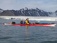 A kayak outside a glacier on Spitzbergen