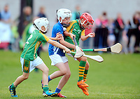 21 Aug 2016:   Colm Maher, right, and David O'Brien, Tipperary, in action against Michael Sammon, Offaly.  Hurling U11 Toomevara of Tipperary (green) v Shinrone/Coolderry of Offaly (blue).   2016 Community Games National Festival 2016.  Athlone Institute of Technology, Athlone, Co. Westmeath. Picture: Caroline Quinn