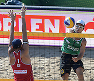 STARE JABLONKI POLAND - July 4: Pedro Solberg Salgado /1/of Brazil and Pablo Herrera Allepuz of Spain in action during Day 4 of the FIVB Beach Volleyball World Championships on July 4, 2013 in Stare Jablonki Poland.  (Photo by Piotr Hawalej)