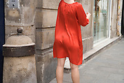 woman in thin red dress
