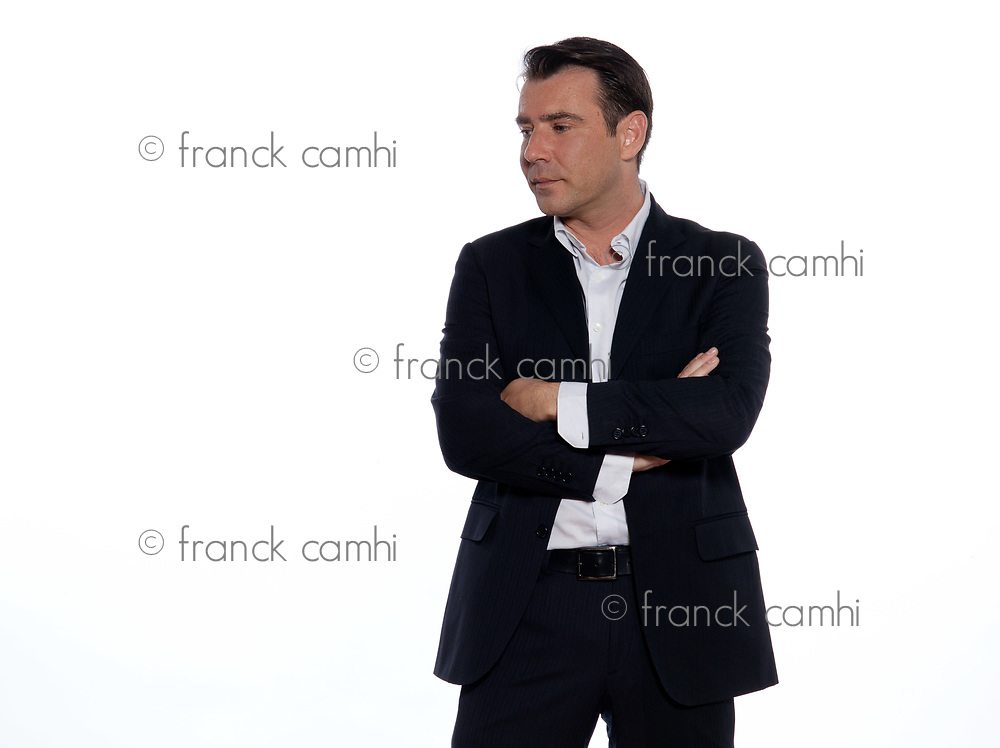 studio portrait on white background of a hansdsome pensive man