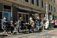 A busy street-side cafe scene in Vesterbro Copenhagen.