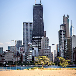 Photo of Chicago skyline at North Avenue Beach in the Lincoln Park neighborhood of Chicago. Skyline includes the popular Hancock Center Building which is one of the most popular and tallest skyscrapers in the world. Photo was taken in 2012 and is high resolution.