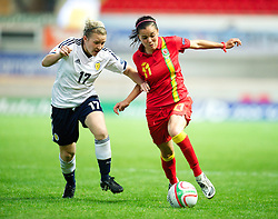 LLANELLI, WALES - Saturday, September 15, 2012: Wales' Gwennan Harries in action against Scotland's Frankie Brown during the UEFA Women's Euro 2013 Qualifying Group 4 match at Parc y Scarlets. (Pic by David Rawcliffe/Propaganda)