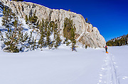 Backcountry skier crossing Mack Lake, John Muir Wilderness, Sierra Nevada Mountains, California  USA
