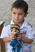 Uzbekistan, Khiva. Boy with puppet.
